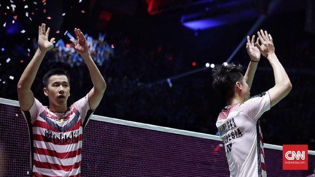 Marcus Fernaldi Gideon/Kevin Sanjaya Sukamuljo seusai memenangi Indonesia Open 2018.