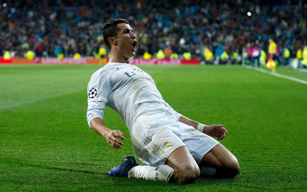 MADRID, SPAIN - APRIL 12:  Cristiano Ronaldo of Real Madrid celebrates as he scores their third goal from a free kick and completes his hat trick during the UEFA Champions League quarter final second leg match between Real Madrid CF and VfL Wolfsburg at Estadio Santiago Bernabeu on April 12, 2016 in Madrid, Spain.  (Photo by Gonzalo Arroyo Moreno/Getty Images)