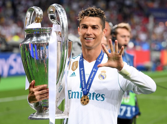 KIEV, UKRAINE - MAY 26:  Cristiano Ronaldo of Real Madrid poses with the UEFA Champions League trophy following the UEFA Champions League Final between Real Madrid and Liverpool at NSC Olimpiyskiy Stadium on May 26, 2018 in Kiev, Ukraine.  (Photo by Laurence Griffiths/Getty Images)
