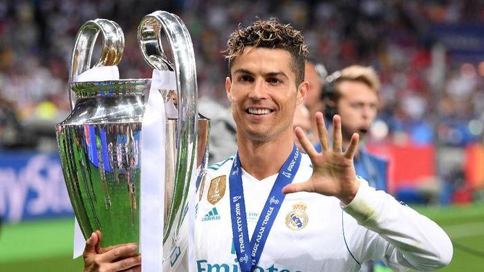 Cristiano Ronaldo total lima kali menjuarai Liga Champions bersama Manchester United dan Real Madrid (Foto: Laurence Griffiths/Getty Images)