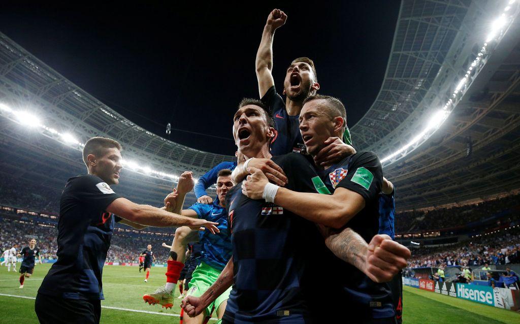 Soccer Football - World Cup - Semi Final - Croatia v England - Luzhniki Stadium, Moscow, Russia - July 11, 2018  Croatia's Mario Mandzukic celebrates scoring their second goal with teammates  REUTERS/Carl Recine