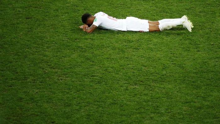 Kekecewaan penyerang Inggris Marcus Rashford setelah timnya kalah dari Kroasia di semifinal Piala Dunia 2018 (Foto: Christian Hartmann/Reuters)
