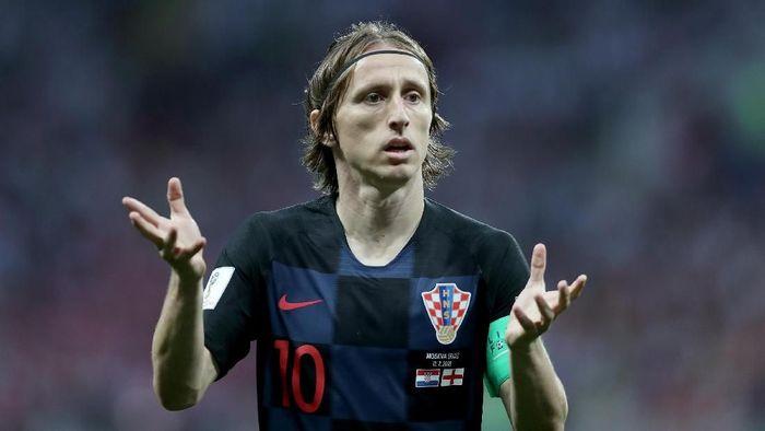 Luka Modric mengakui Piala Dunia 2018 menguras energinya (Foto: Clive Rose/Getty Images)