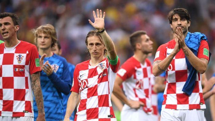 Luka Modric dan Kroasia harus puas sebagai runner-up Piala Dunia 2018. (Foto: Laurence Griffiths/Getty Images)