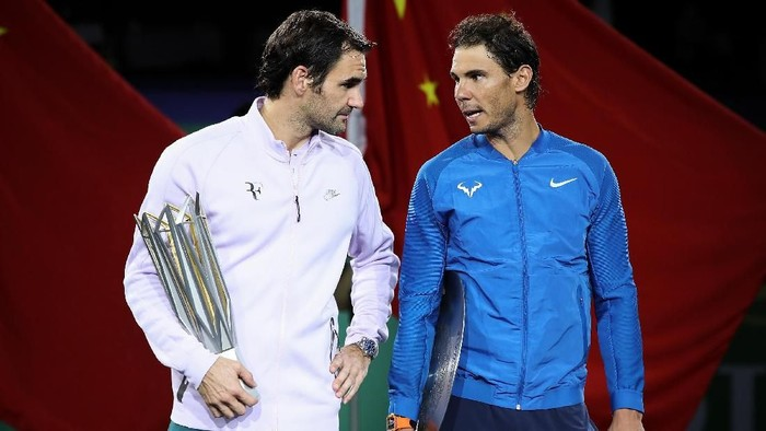SHANGHAI, CHINA - OCTOBER 15:  Roger Federer of Switzerland with Rafael Nadal of Spain pose with their trophy after the Mens singles final mach on day eight of 2017 ATP Shanghai Rolex Masters at Qizhong Stadium on October 15, 2017 in Shanghai, China.  (Photo by Lintao Zhang/Getty Images)