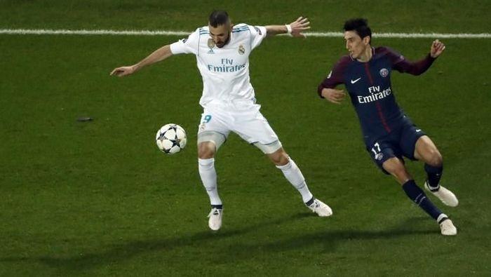 Karim Benzema dan Angel Di Maria. (Foto: Thomas Samson/AFP)