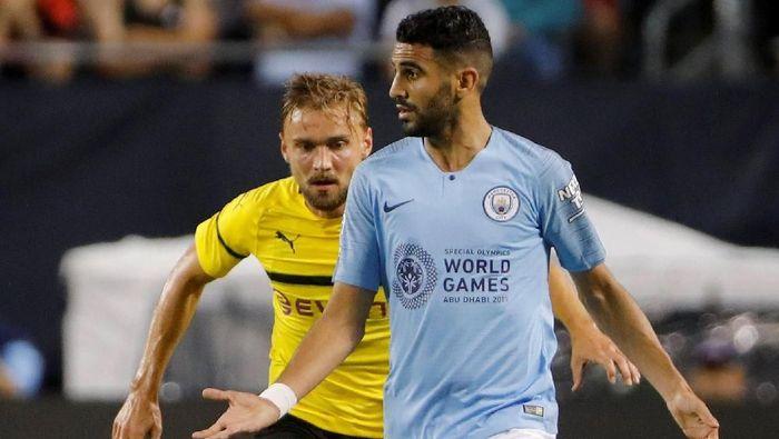 Manchester City tak lagi jor-joran di musim panas ini. Mereka menghabiskan 63,1 juta pound sterling, yang nyaris semuanya digelontorkan untuk menebus Riyad Mahrez dari Leicester City. (Foto: John Gress/Reuters)