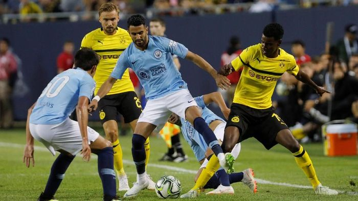 Riyad Mahrez menjalani debut di Manchester City (Foto: John Gress/Reuters)