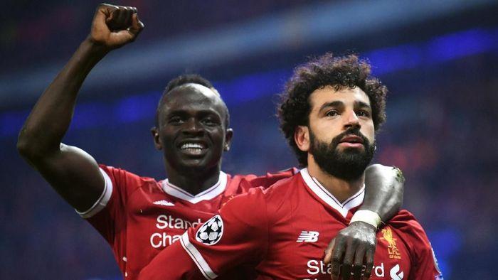 Mohamed Salah dan Sadio Mane kemungkinan besar tampil lawan City. (Foto: Laurence Griffiths/Getty Images)