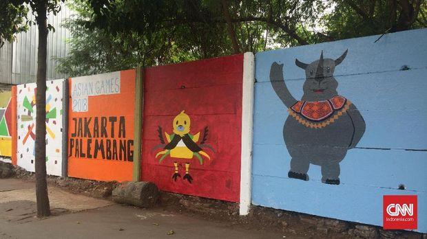 Mural bertema Asian Games 2018 di depan kantor Kelurahan Paseban, Jakpus, Rabu (24/7).