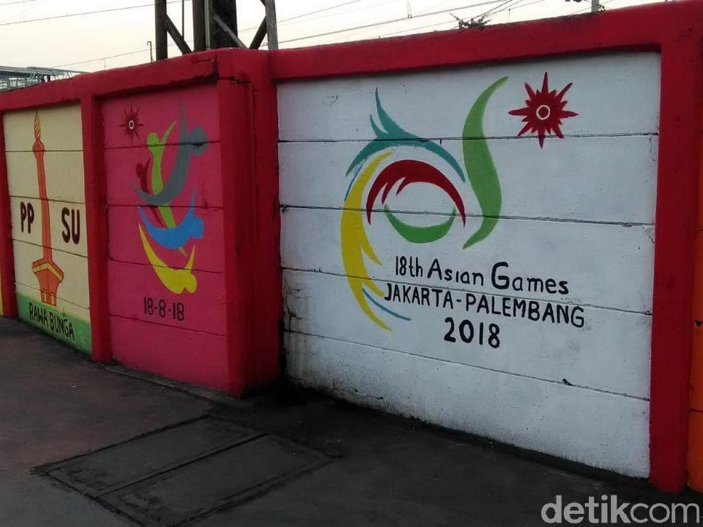 Foto: Warna-warni Mural Asian Games Pasukan Oranye di Jatinegara