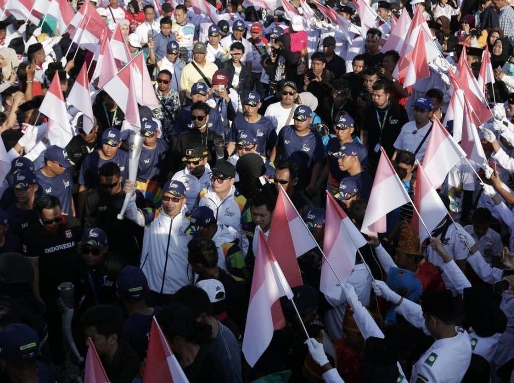 Pertamina Ramaikan Kirab Obor Asian Games di Makassar
