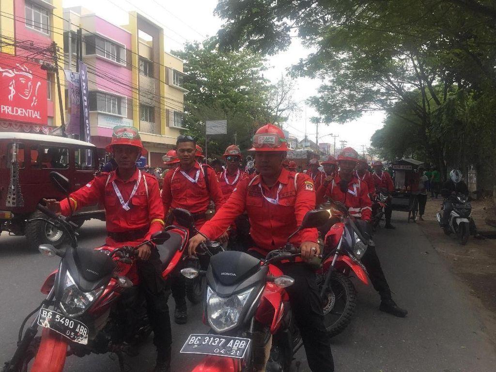 Regu Pemadam Kebakaran APP Sinar Mas Kawal Kirab Obor Asian Games