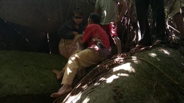 H (28), warga Tolitoli, ditemukan di antara bebatuan raksasa setelah 15 tahun menghilang