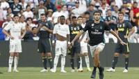 Pertandingan sendiri sempat terganggu ulah suporter Madrid yang masuk ke lapangan. Dia lantas dibekuk petugas keamanan. (Foto: Geoff Burke-USA TODAY Sports/REUTERS)