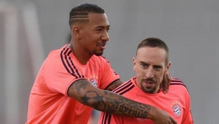 Jerome Boateng dan Franck Ribery. (Foto: Christof Stache/AFP Photo)