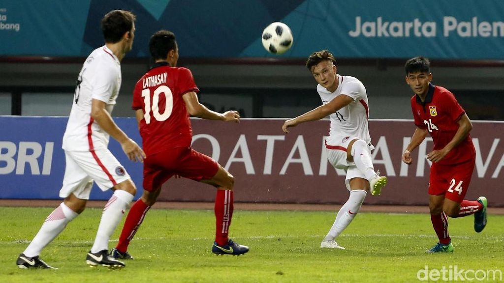 Laga Perdana Sepakbola Asian Games, Hong Kong Libas Laos