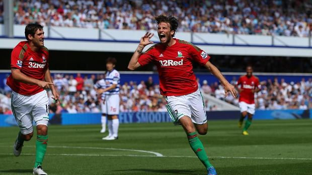LONDON, ENGLAND - AUGUST 18:  Michu of Swansea celebrates scoring the opening goal during the Barclays Premier League match between Queens Park Rangers and Swansea City at Loftus Road on August 18, 2012 in London, England.  (Photo by Richard Heathcote/Getty Images)