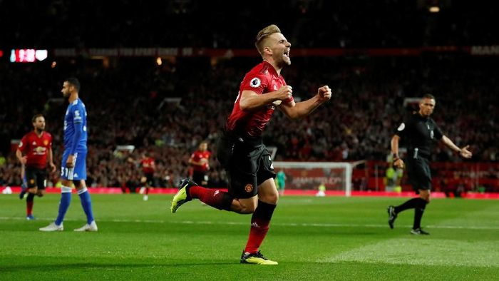 Bek kiri Manchester United Luke Shaw merayakan golnya ke gawang Leicester City (Foto: Andrew Boyers/Action Images via Reuters)