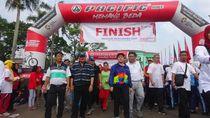 Menteri Puan Jalan Sehat 3,7 Km Bersama 15 Ribu Pelajar di Sumsel