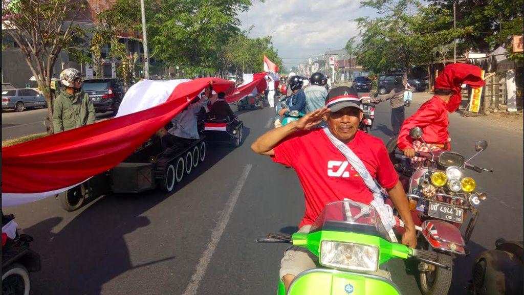 Saat Bendera Merah Putih Sepanjang 73 Meter Penuhi Jalanan Makasar