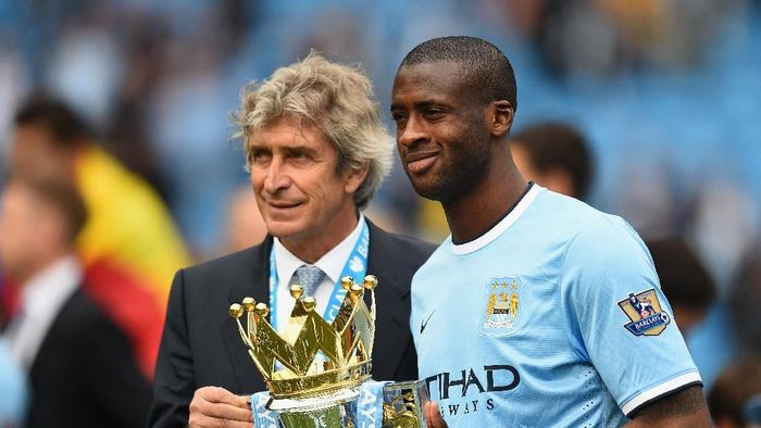 Yaya Toure dan Manuel Pellegrini saat masih di Manchester City (Shaun Botterill/Getty Images)