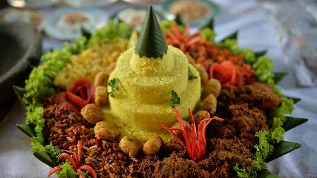Tumpeng is a cone-shaped rice dish like mountain with its side dishes (vegetables and meat). Traditionally featured in the slamatan ceremony, the cone shape of rice is made by using cone-shaped woven bamboo container. The rice itself could be plain steamed rice, uduk rice (cooked with coconut milk), or yellow rice (uduk rice colored with kunyit (turmeric)).
