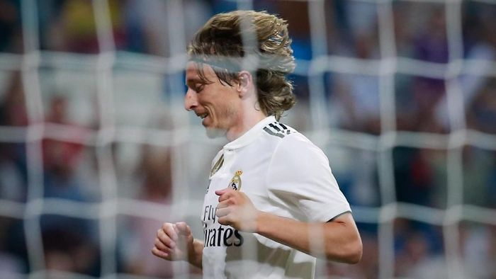 Ekspresi Luka Modric saat menyabet gelar pemain terbaik dunia versi FIFA. (Gonzalo Arroyo Moreno/Getty Images)