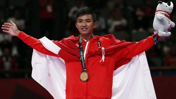 Rifki Ardiansyah meraih medali emas Asian Games 2018 di cabang olahraga karate.