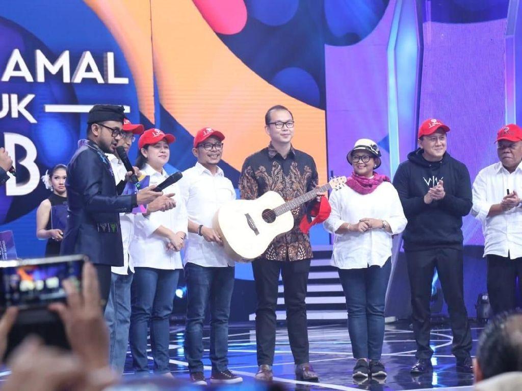 Konser Amal Lombok, Gitar Menaker Laku Dilelang Rp 1 Miliar