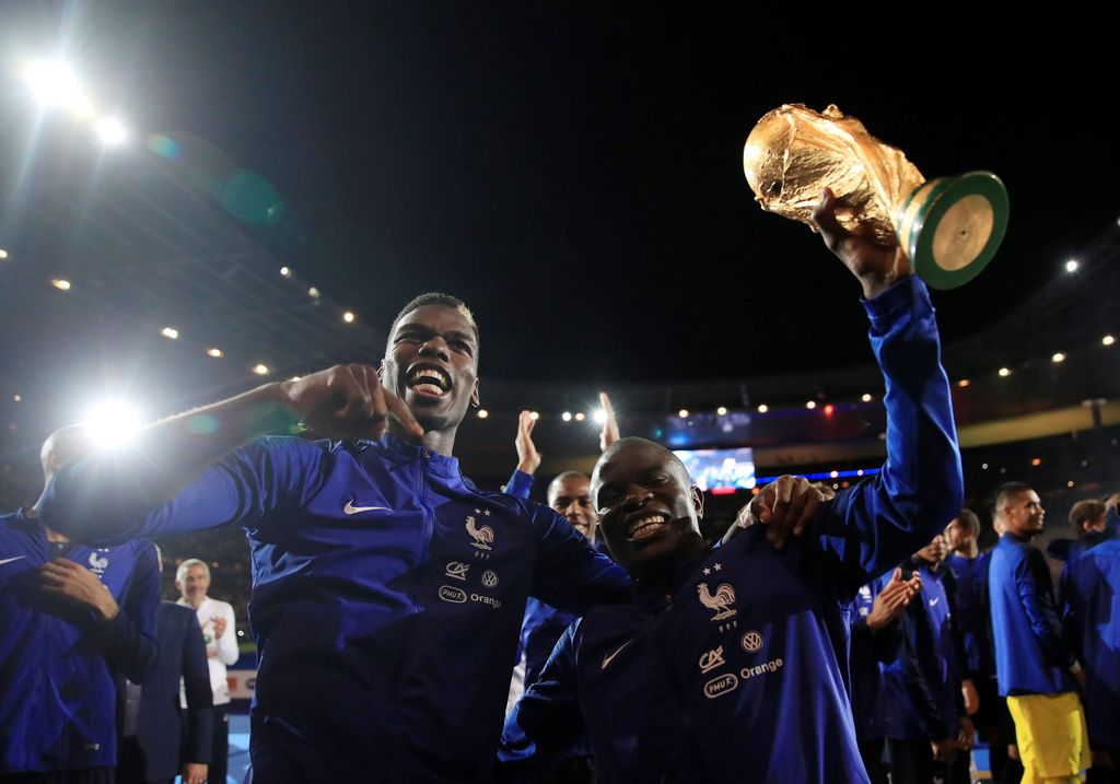 Soccer Football - UEFA Nations League - League A - Group 1 - France v Netherlands - Stade de France, Saint-Denis, France - September 9, 2018  France's N'Golo Kante and Paul Pogba celebrate with the World Cup trophy during a ceremony after the match  REUTERS/Gonzalo Fuentes
