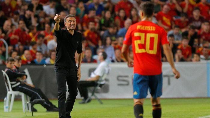 Sergio Ramos akan mendedikasikan kemenangan Spanyol untuk Luis Enrique yang barus saja mundur dari kursi pelatih (Foto: Heino Kalis/Reuters)