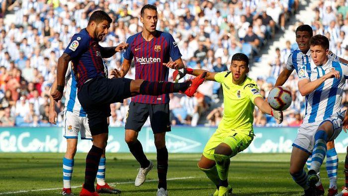 Barcelona melanjutkan start sempurnanya di Liga Spanyol dengan mengalahkan Real Sociedad 2-1 (Foto: Paul Hanna/Reuters)