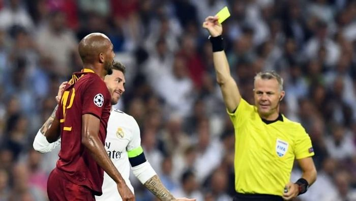 Sergio Ramos kini tercatat sebagai pemain dengan kartu kuning terbanyak di Liga Champions (Foto: GABRIEL BOUYS/AFP PHOTO)