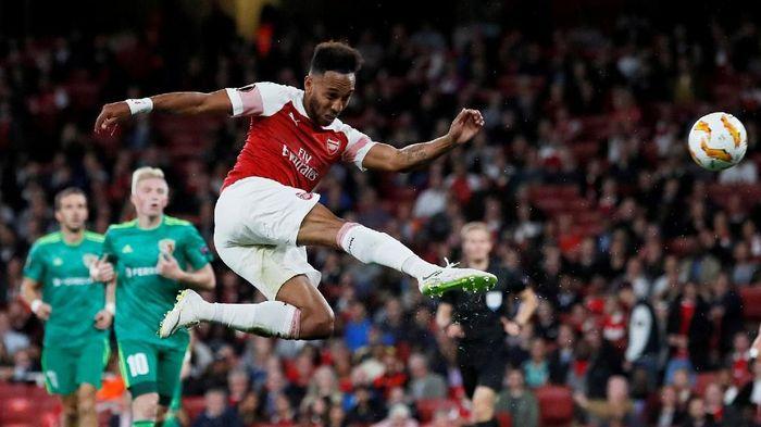 Pierre-Emerick Aubameyang jadi bintang kemenangan Arsenal lewat sepasang gonya (David Klein/REUTERS)