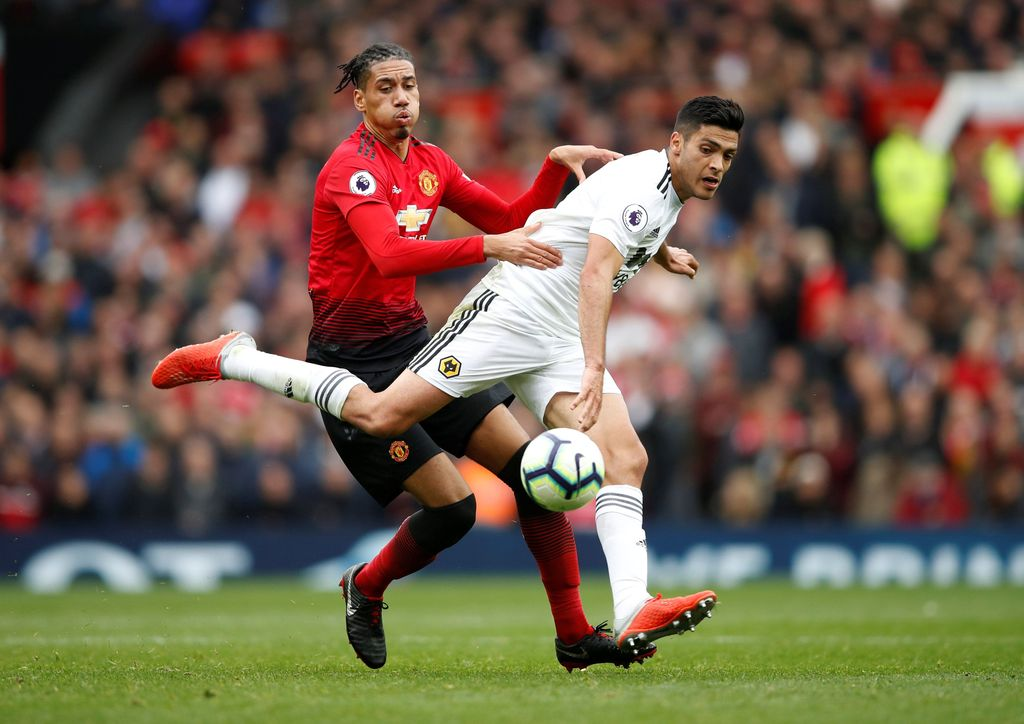 Soccer Football - Premier League - Manchester United v Wolverhampton Wanderers - Old Trafford, Manchester, Britain - September 22, 2018  Manchester United's Chris Smalling in action with Wolverhampton Wanderers' Raul Jimenez         Action Images via Reuters/Carl Recine  EDITORIAL USE ONLY. No use with unauthorized audio, video, data, fixture lists, club/league logos or