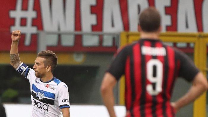 AC Milan punya wajah yang berbeda di dua babak laga dengan Atalanta (Marco Luzzani/Getty Images)