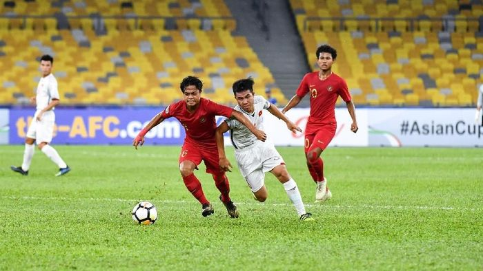 Timnas Indonesia U-16 berimbang 1-1 kontra Vietnam di Piala Asia. (Foto: Adam Aidil Padali/AFC)