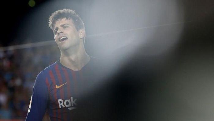 Blunder Gerard Pique membuat Barcelona kalah di kandang Leganes 1-2. (Foto: Pau Barrena/AFP Photo)