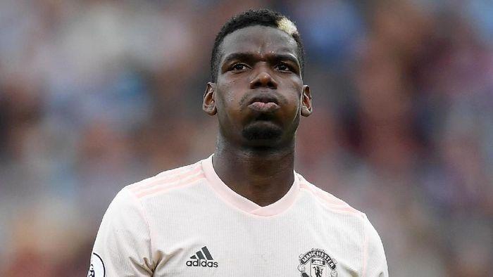 Paul Pogba mengklaim dirinya tak diperbolehkan bicara di depan umum (Foto: Shaun Botterill/Getty Images)