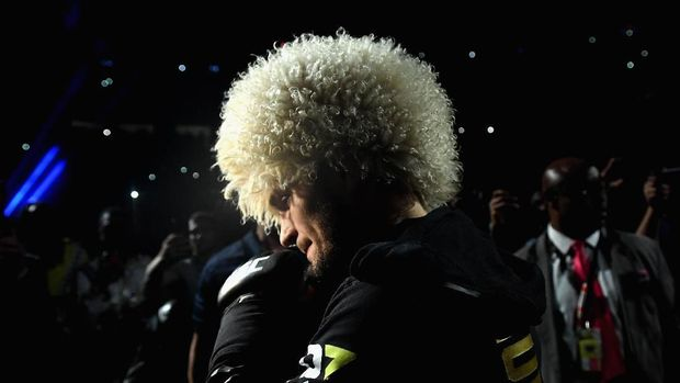 LAS VEGAS, NV - OCTOBER 06: Khabib Nurmagomedov of Russia makes his entrance before competing against Conor McGregor of Ireland in their UFC lightweight championship bout during the UFC 229 event inside T-Mobile Arena on October 6, 2018 in Las Vegas, Nevada.   Harry How/Getty Images/AFP
