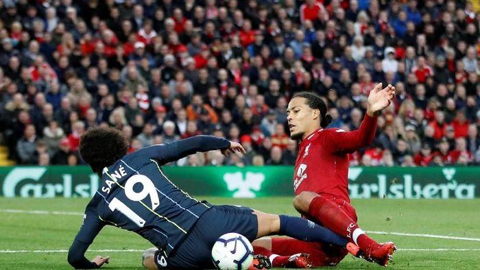 Manchester City dan Liverpool bersaing ketat memperebutkan gelar juara (Carl Recine/Reuters)