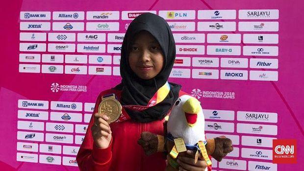 Evi Karisma merebut medali emas kesembilan Indonesia di Asian Para Games 2018.