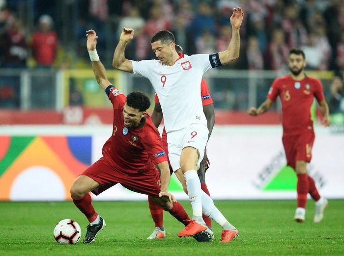 Portugal mengalahkan Polandia 3-2 dalam lanjutan UEFA Nations League. (Foto: Radoslaw Jozwiak/Reuters)