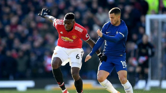 Paul Pogba antusias menghadapi Eden Hazard yang tengah on fire. (Foto: Laurence Griffiths/Getty Images)
