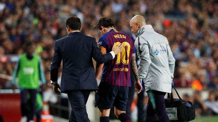 Lionel Messi harus absen selama tiga pekan karena cedera (Foto: Albert Gea/Reuters)