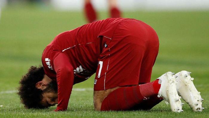 Mohamed Salah bikin gol sekaligus mengakhiri puasa di empat laga terakhir (Carl Recine/Reuters)