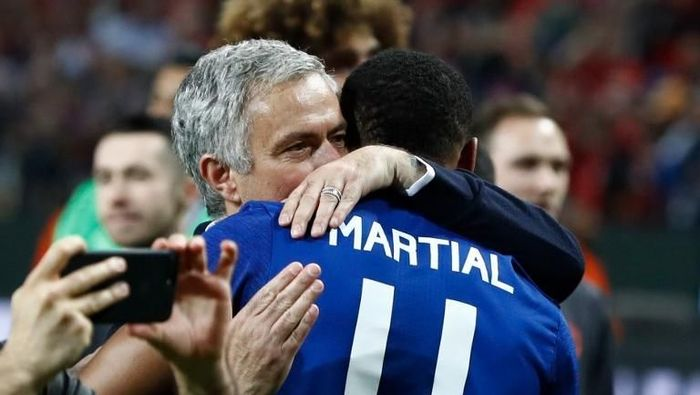 Manchester Uniteds Portuguese manager Jose Mourinho celebrates French striker Anthony Martial after the UEFA Europa League final football match Ajax Amsterdam v Manchester United on May 24, 2017 at the Friends Arena in Solna outside Stockholm. (Photo by Odd ANDERSEN / AFP)