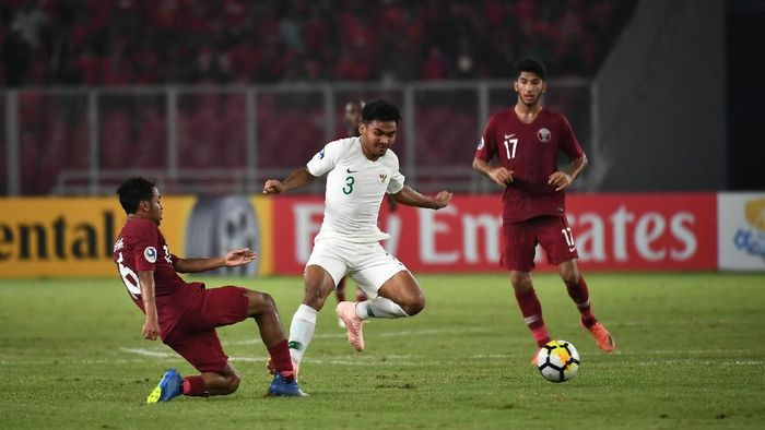 Asnawi Mangkualam Bahar di laga Qatar vs Indonesia. (Foto: Robertus Pudyanto Hari Pribadi/AFC)