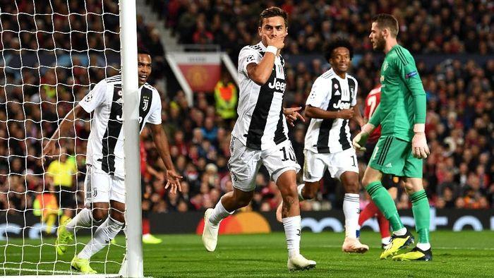 Paulo Dybala membawa Juventus memimpin 1-0 atas Manchester United. (Foto: Michael Regan/Getty Images)